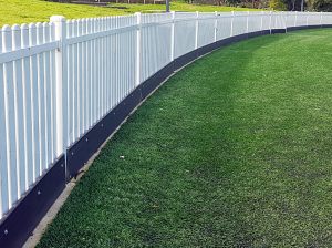under fence plinth